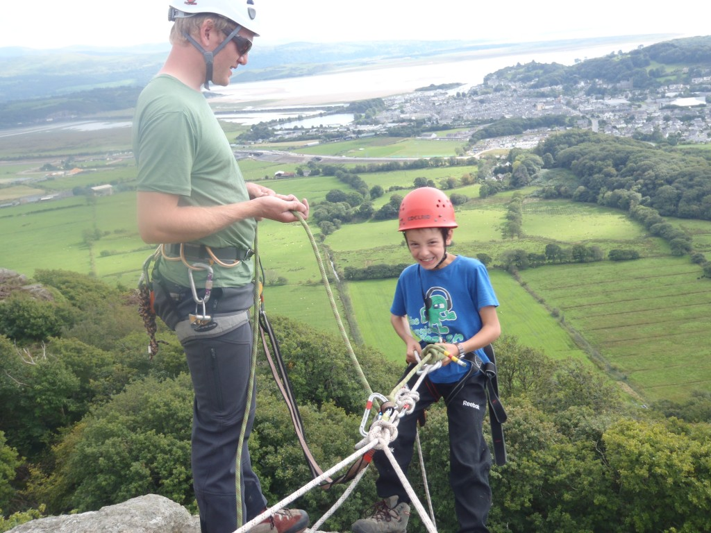 Young climber getting to grips with Abseiling