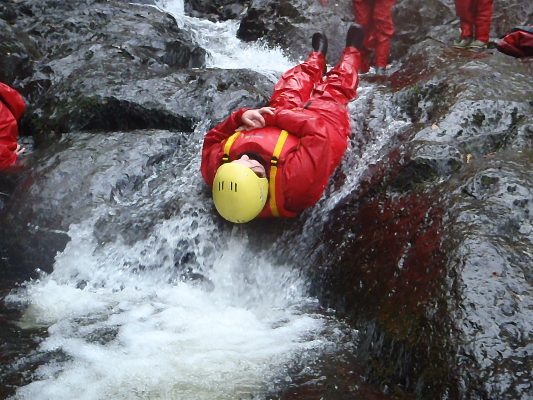 Dropping into a pool while gorge scrambling